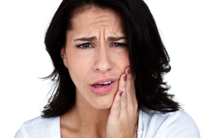 Emergency dental care patient experiencing tooth pain in Scarsdale