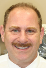 White Plains cosmetic dentist Dr. Handschuh gives another dentist a new smile with porcelain veneers